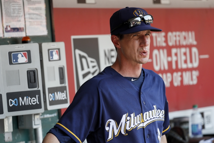 Milwaukee Brewers manager Craig Counsell stands in the dugout during the fourth inning of a baseball game against the Cincinnati Reds, Sunday, July 1, 2018, in Cincinnati. (AP Photo/John Minchillo)