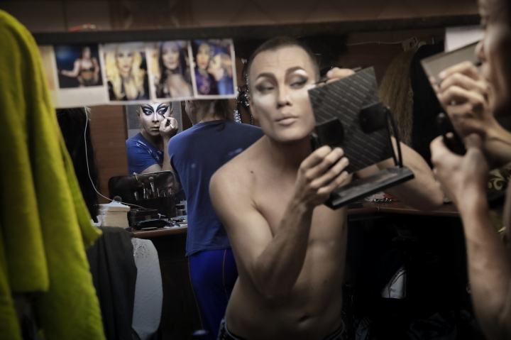 In this picture taken Sunday, June 24, 2018, Sergey, left, who uses the stage name Bomba (the bomb), and Andrei, who goes by the name of Star Vasha apply make-up backstage before performing at the Fame gay club during the 2018 soccer World Cup in Yekaterinburg, Russia. As long as the World Cup is under way and the international spotlight is shining on Russia, authorities are forced to ease their pressure on the LGBT community, but some worry about what happens after the tournament ends.(AP Photo/Vadim Ghirda)