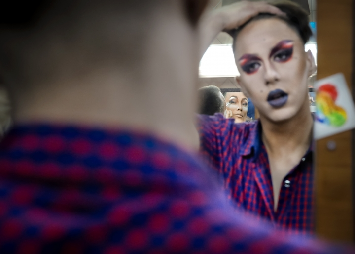 """In this picture taken Sunday, June 24, 2018, Andrei, center background, who goes by the stage name of Star Vasha and Dmitry, who performs under the name of Africa, apply make-up backstage before performing at the Fame gay club during the 2018 soccer World Cup in Yekaterinburg, Russia. Africa, aka Dmitry, describes how he stays safe in the face of a mentality of """"pitchforks and torches"""" toward Russia's LGBT community: """"When people talk about homosexuality, you try to change the subject."""" And leave your bright-colored sneakers at home. (AP Photo/Vadim Ghirda)"""
