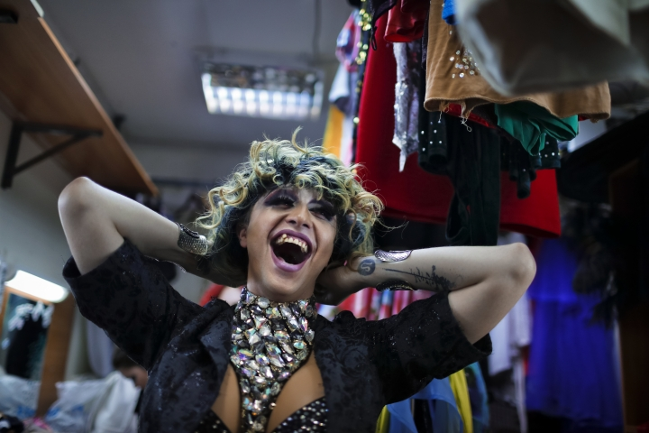 In this picture taken Sunday, June 24, 2018, Markus, who uses the stage name Linda Fox, laughs backstage at the Fame gay club, during the 2018 soccer World Cup in Yekaterinburg, Russia. Backstage, performers are sometimes pensive. But sometimes laughter takes over, and broad smiles are all you see.(AP Photo/Natacha Pisarenko)
