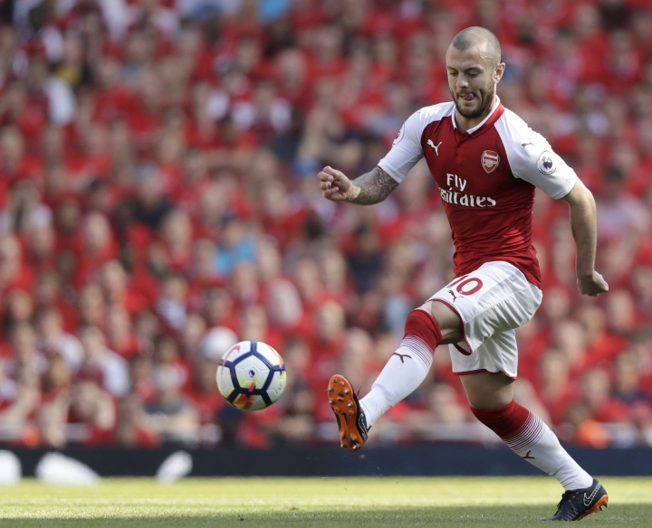 FILE - In this file photo dated Sunday, May 6, 2018, Arsenal's Jack Wilshere in action during the English Premier League soccer match against Burnley at the Emirates Stadium in London. Free agent Jack Wilshere has ended his long stay at Arsenal Monday July 9, 2018, by signing a three-year contact to move to London rival West Ham. (AP Photo/Matt Dunham, FILE)