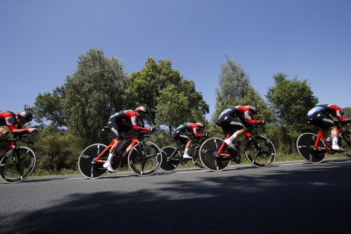 BMC Racing Team strains during the third stage of the Tour de France cycling race, a team time trial over 35.5 kilometers (22 miles) with start and finish in Cholet, France, Monday, July 9, 2018. (AP Photo/Christophe Ena )