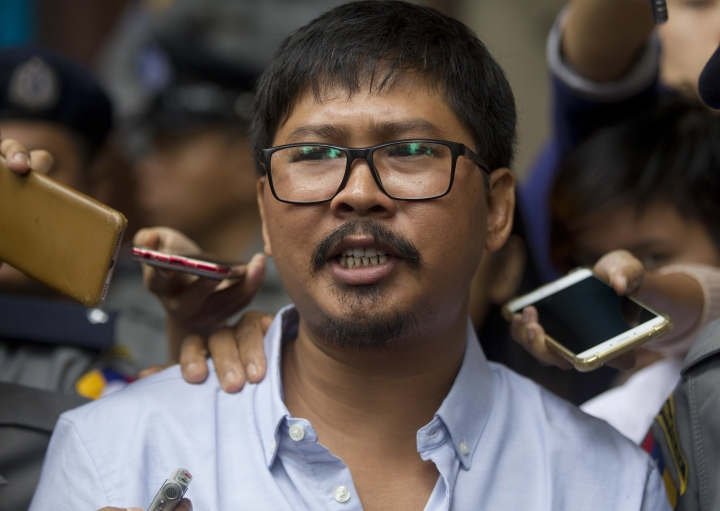 Reuters journalist Wa Lone talks to journalists as he leaves the court after trial Monday, July 9, 2018, in Yangon, Myanmar. (AP Photo/Thein Zaw)