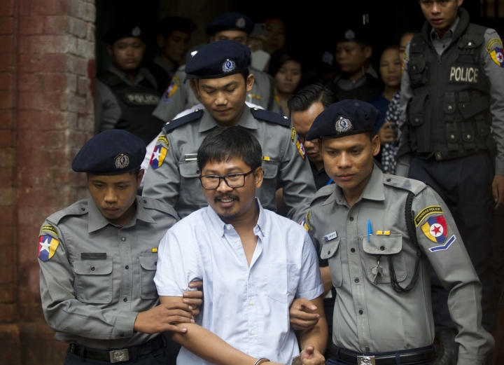 Reuters journalist Wa Lone, center, is escorted by police as he leaves the court after trial Monday, July 9, 2018, in Yangon, Myanmar. (AP Photo/Thein Zaw)