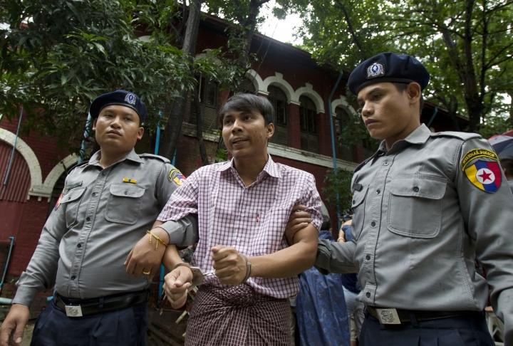 Reuters journalist Kyaw Soe Oo talks to journalists as he leaves the court after trial Monday, July 9, 2018, in Yangon, Myanmar. (AP Photo/Thein Zaw)