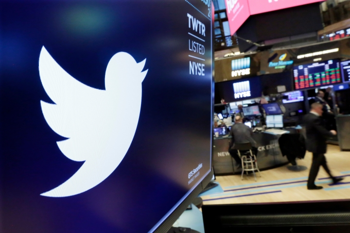 FILE - In this Feb. 8, 2018, file photo the logo for Twitter is displayed above a trading post on the floor of the New York Stock Exchange. Twitter shares tumbled Monday, July 9, after a news report quantified its purge of fake and malicious accounts, noting that the aggressive action could harm its user growth. (AP Photo/Richard Drew, File)