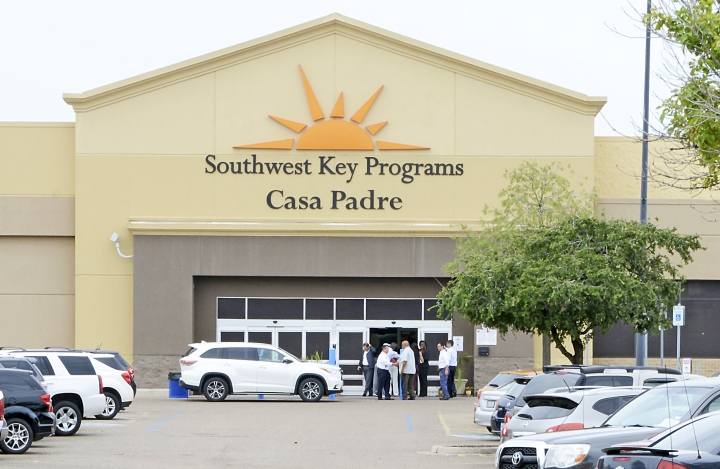 """FILE - In this June 18, 2018 file photo, dignitaries take a tour of Southwest Key Programs Casa Padre, a U.S. immigration facility in Brownsville, Texas, where children who have been separated from their families are detained. The American Civil Liberties Union says it appears the Trump administration will miss a Tuesday, July 10 deadline to reunite young children with their parents in more than half of the cases. The group said the administration provided it with a list of 102 children under 5 years old who must be reunited by Tuesday under an order by U.S. District Judge Dana Sabraw in San Diego. It said in a statement that it """"appears likely that less than half will be reunited"""" by that deadline. (Miguel Roberts /The Brownsville Herald via AP, File)"""
