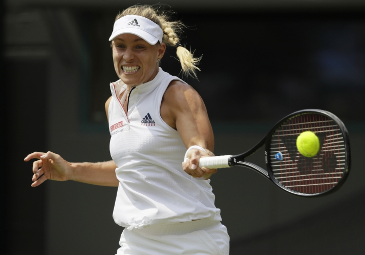 Angelique Kerber of Germany returns to Belinda Bencic of Switzerland during their women's singles match on the seventh day at the Wimbledon Tennis Championships in London, Monday July 9, 2018. (AP Photo/Kirsty Wigglesworth)