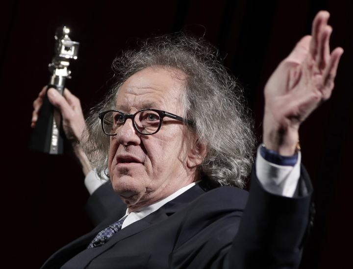 "FILE - In this Feb. 11, 2017, file photo, Australian actor Geoffrey Rush poses with his Berlinale Camera Award which he received prior to the screening of the film ""Final Portrait"" at the 2017 Berlinale Film Festival in Berlin, Germany. Rush has pulled out of a Shakespeare stage production in the Australian city of Melbourne as he sues a Sydney newspaper for defamation. (AP Photo/Michael Sohn, File)"