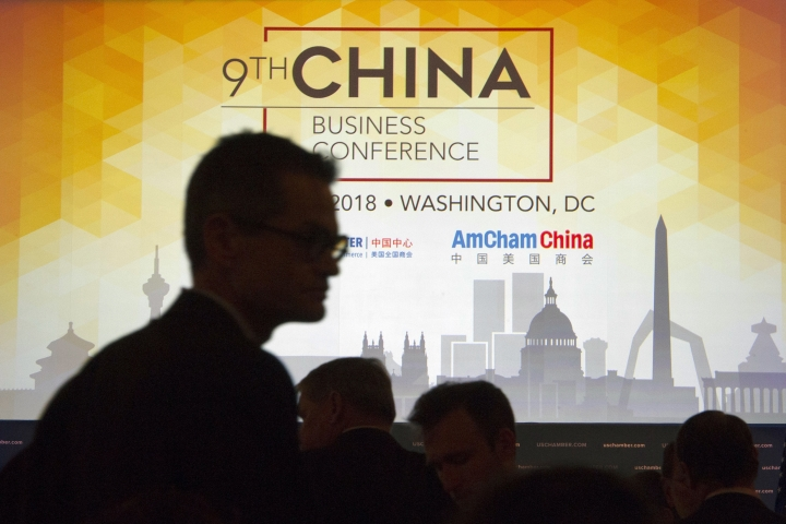 FILE - In this Tuesday, May 1, 2018, file photo, people take their seats before U.S. Trade Representative Robert Lighthizer speaks at the 9th China Business Conference at the U.S. Chamber of Commerce in Washington. China's options to retaliate in an escalating trade dispute with Washington go beyond matching U.S. tariff hikes to targeting American companies and government debt. Its state-dominated economy gives regulators tools to hamper sales of engineering, shipping and other services _ an area in which the United States runs a trade surplus _ and to disrupt operations for automakers, restaurant chains and other American businesses in China. (AP Photo/Cliff Owen, File)