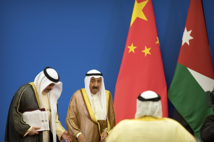 Kuwait's ruling emir, Sheikh Sabah Al Ahmad Al Sabah, center, leaves the stage after speaking during the opening session of the 8th Ministerial Meeting of the China-Arab States Cooperation Forum in Beijing, Tuesday, July 10, 2018. China's President Xi Jinping has pledged more than $23 billion in lines of credit, loans and humanitarian assistance to Arab countries in a major push for influence in the region. (AP Photo/Mark Schiefelbein)