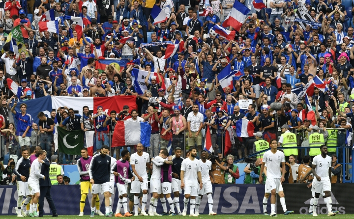FILE - In this Friday, July 6, 2018 file photo France players and supporters celebrate after the quarterfinal match between Uruguay and France at the 2018 soccer World Cup in the Nizhny Novgorod Stadium, in Nizhny Novgorod, Russia. (AP Photo/Martin Meissner, File)