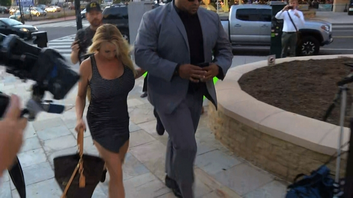 In this image from video, Stormy Daniels arrives at the strip club Cloakroom for a performance Monday, July 9, 2018, in Washington. (Tom Sampson/APTN via AP)