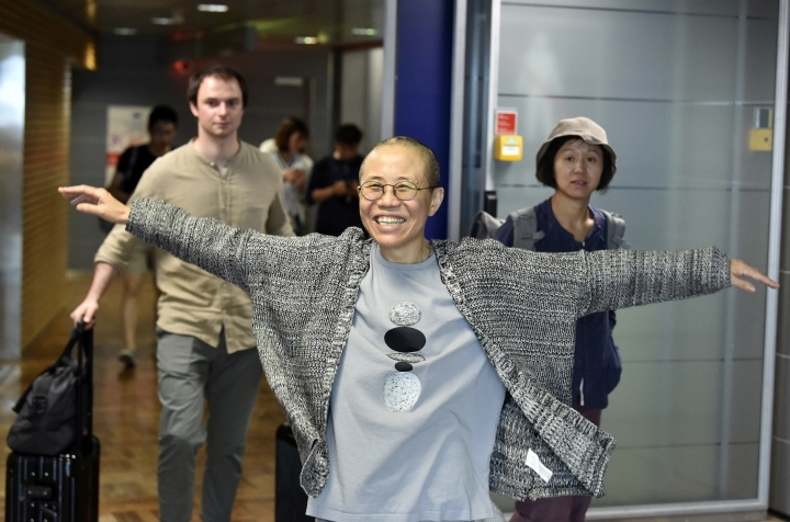 Liu Xia, the widow of Chinese Nobel dissident Liu Xiaobo, gestures she arrives at the Helsinki International Airport in Vantaa, Finland, Tuesday, July 10, 2018. China on Tuesday allowed Liu Xia to fly to Berlin, ending an eight-year house arrest that had drawn intense international criticism and turned the 57-year old poet _ who reluctantly followed her husband into politics two decades ago _ into a tragic icon known around the world. (Jussi Nukari/ Lehtikuva via AP)
