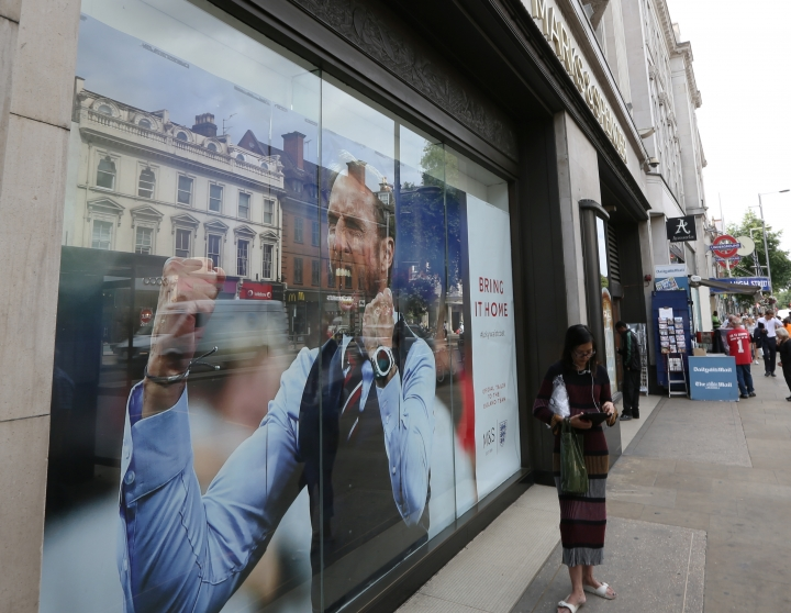 The window of a Marks and Spencer store displaying England head coach Gareth Southgate in London, showing support for the England soccer team. The soft-spoken Southgate in a simple blue waistcoat seems to be uniting Britain amid dreams of victory in soccer's World Cup, with their next match against Croatia on upcoming Wednesday. (Robert Stevens/AP Photo)