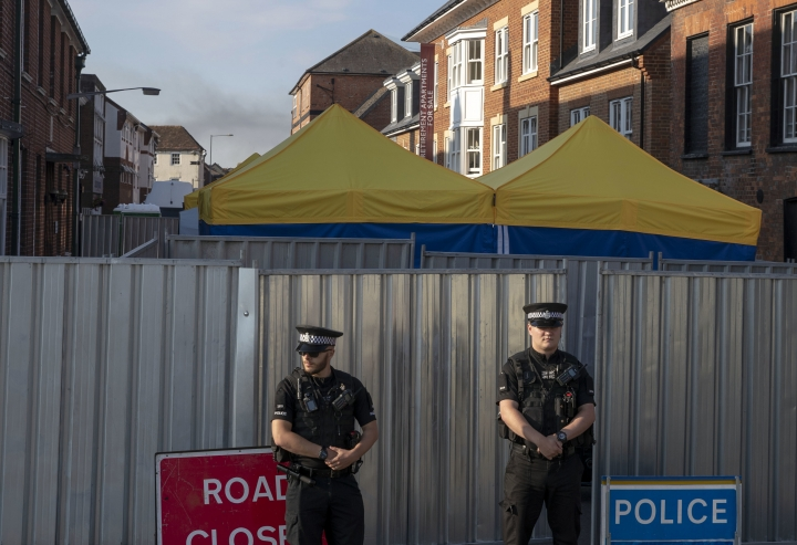 Police secure a point of interest in Salisbury, where counter-terrorism officers are investigating after a woman and her partner were exposed to the nerve agent Novichok, Monday July 9, 2018. Police said this is now a homicide investigation after 44-year-old Dawn Sturgess died Sunday following her poisoning.(Steve Parsons/PA via AP)