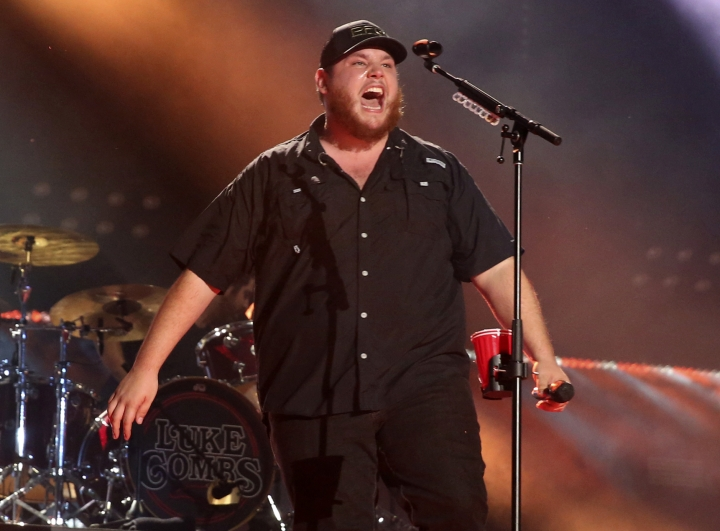 """FILE - In this June 8, 2018 file photo, artist Luke Combs performs at the 2018 CMA Music Festival in Nashville, Tenn. A year after his major label debut, which spawned three top country radio hits including the multiplatinum No. 1 """"Hurricane,"""" Combs' unassuming appeal has given him mainstream success at a breakneck pace. His debut album is the most streamed country album of the year. (Photo by Laura Roberts/Invision/AP, File)"""