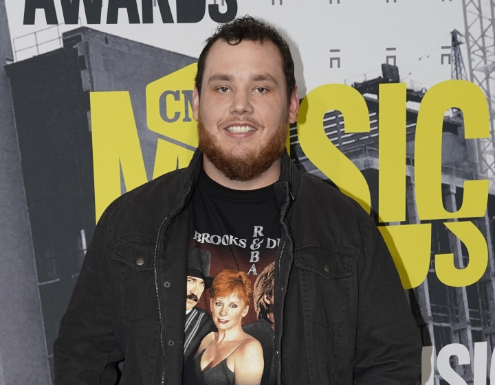 """FILE - In this June 7, 2017 file photo, Luke Combs arrives at the CMT Music Awards in Nashville, Tenn. A year after his major label debut, which spawned three top country radio hits including the multiplatinum No. 1 """"Hurricane,"""" Combs' unassuming appeal has given him mainstream success at a breakneck pace. His debut album is the most streamed country album of the year. (Photo by Sanford Myers/Invision/AP, File)"""