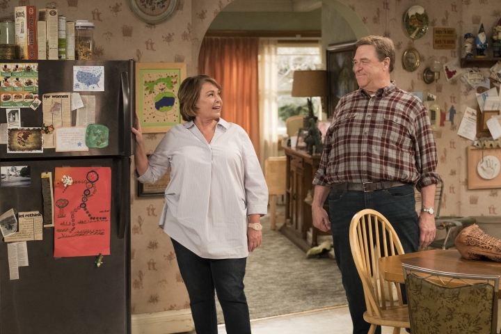 "This image released by ABS shows Roseanne Barr, left, and John Goodman in a scene from the comedy series ""Roseanne."" ABC's ""Roseanne"" revival is in the running for Emmy nominations Thursday, but will TV academy voters overlook its star's racist tweet that brought the sitcom to an abrupt end? (Adam Rose/ABC via AP)"