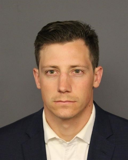 FILE - This undated file photo provided by the Denver Police Department shows Chase Bishop. Investigators say the FBI agent accidentally fired a weapon that fell while he was dancing at a Denver nightspot and wounded another patron in the leg. A judge said Tuesday, July 10, 2018, that Bishop can carry his gun on and off duty while his case is pending. He is charged with second-degree assault in the June 2 shooting. (Denver Police Department via AP, File)