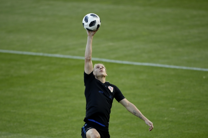 Croatia's Domagoj Vida jumps to catch a ball during a training session in the Luzhniki sport ground at 2018 soccer World Cup in Moscow, Russia, Monday, July 9, 2018. (AP Photo/Francisco Seco)