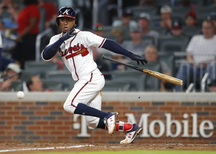 Atlanta Braves Ozzie Albies watches his bunt single during the sixth inning of the team's baseball game against the Toronto Blue Jays, Tuesday, July 10, 2018, in Atlanta. (AP Photo/Todd Kirkland)