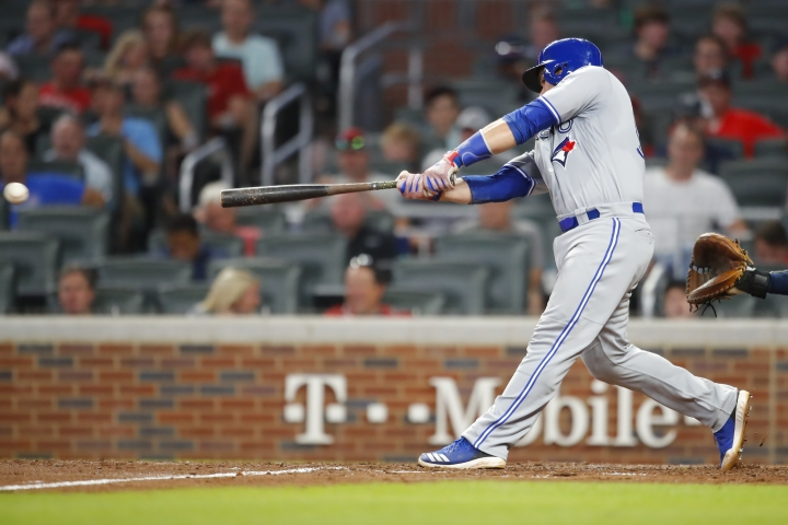 Toronto Blue Jays' Russell Martin swings for an RBI single during the eighth inning of the team's baseball game against the Atlanta Braves, Tuesday, July 10, 2018, in Atlanta. (AP Photo/Todd Kirkland)