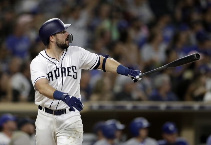 San Diego Padres' Austin Hedges watches his three-run home run during the fifth inning of the teams baseball game against the Los Angeles Dodgers on Tuesday, July 10, 2018, in San Diego. (AP Photo/Gregory Bull)