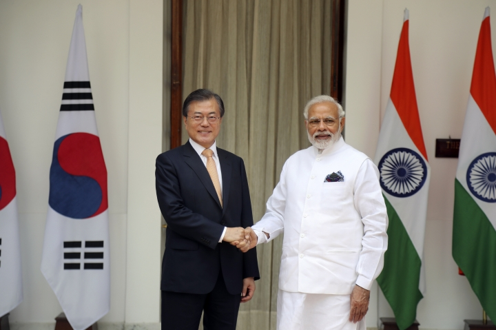 South Korean President Moon Jae-in, left, shakes hand with Indian Prime Minister Narendra Modi before their meeting in New Delhi, India, Tuesday, July 10, 2018. Moon is on a three- day visit to India. (AP Photo/Manish Swarup)