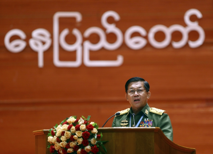 Myanmar's Army Commander Senior Gen. Min Aung Hlaing speaks during the opening ceremony of the third session of the 21st Century Panglong Conference at the Myanmar International Convention Centre in Naypyitaw, Myanmar, Wednesday, July 11, 2018. Myanmar's leader Aung San Suu Kyi and the country's military commander have opened the major conference with representatives of ethnic minority groups to try to reach a lasting peace after seven decades of strained relations and armed conflict. (AP Photo/Aung Shine Oo)
