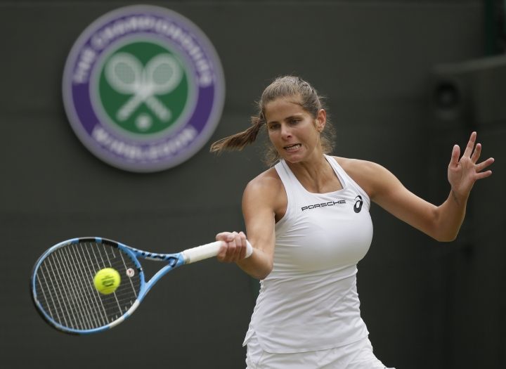 Julia Goerges of Germany returns to Kiki Bertens of the Netherlands during their women's quarterfinal match at the Wimbledon Tennis Championships in London, Tuesday July 10, 2018. (AP Photo/Tim Ireland)