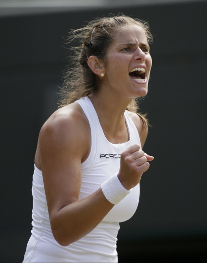 Julia Goerges of Germany celebrates winning a game from Kiki Bertens of the Netherlands during their women's quarterfinal match at the Wimbledon Tennis Championships in London, Tuesday July 10, 2018. (AP Photo/Tim Ireland)