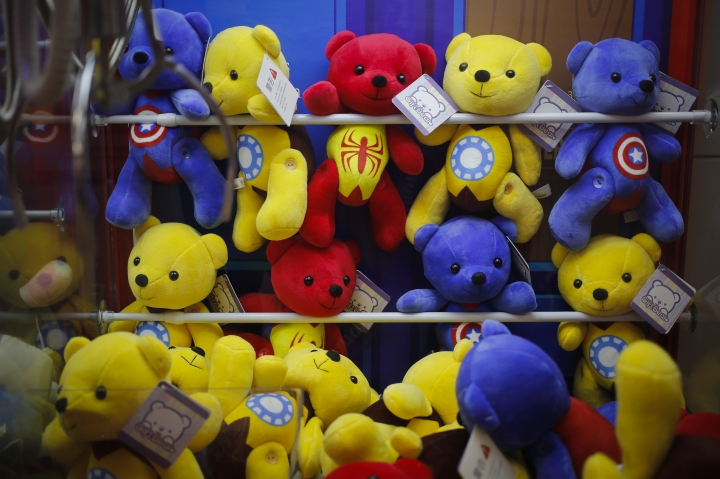 "Chinese-made teddy bears carrying American hit movie Avengers characters are displayed inside an arcade game at a shopping mall in Beijing, Wednesday, July 11, 2018. China's government has criticized the latest U.S. threat of a tariff hike as ""totally unacceptable"" and vowed to retaliate in their escalating trade war. The Commerce Ministry on Wednesday gave no details, but Beijing responded to last week's U.S. tariff hike on $34 billion of imports from China by increasing its own duties on the same amount of American goods. (AP Photo/Andy Wong)"