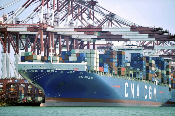 "In this July 6, 2018, photo, a container ship is docked at a port in Qingdao in eastern China's Shandong Province. China's government on Wednesday, July 11, 2018, has criticized the latest U.S. threat of a tariff hike as ""totally unacceptable"" and vowed to retaliate in their escalating trade war. (Chinatopix via AP)"