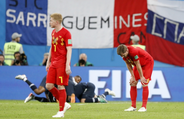 Belgium's Jan Vertonghen, right, and Belgium's Kevin De Bruyne stand at the end of the semifinal match between France and Belgium at the 2018 soccer World Cup in the St. Petersburg Stadium, in St. Petersburg, Russia, Tuesday, July 10, 2018. France won 1-0. (AP Photo/David Vincent)