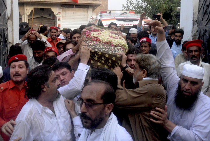People carry the coffin of Pakistani politician Haroon Ahmed Bilour, a victim of a suicide bombing at an election rally for burial in Peshawar, Pakistan, Wednesday, July 11, 2018. The Pakistani Taliban on Wednesday claimed responsibility for an overnight suicide bombing at a rally that killed Bilour, a secular politician and 20 others two weeks before nationwide elections. (AP Photo/Muhammad Sajjad)