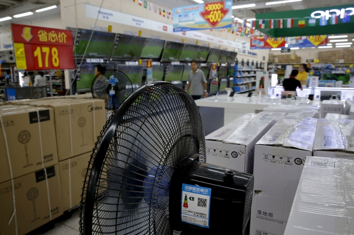 "Chinese brand home appliances sit on display for sale at a hypermarket in Beijing, Wednesday, July 11, 2018. China's government has criticized the latest U.S. threat of a tariff hike as ""totally unacceptable"" and vowed to retaliate in their escalating trade war. The Commerce Ministry on Wednesday gave no details, but Beijing responded to last week's U.S. tariff hike on $34 billion of imports from China by increasing its own duties on the same amount of American goods. (AP Photo/Andy Wong)"