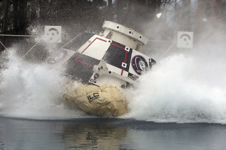 In this Feb. 9, 2016 photo made available by NASA, a mockup of Boeing's CST-100 Starliner spacecraft, in development in partnership with NASA's Commercial Crew Program, splashes into a 20-foot-deep basin at NASA's Langley Research Center in Hampton, Va., during testing of the spacecraft's landing systems design. On Wednesday, July 11, 2018, the U.S. Government Accountability Office said NASA needs a backup plan for getting astronauts to space, given additional delays on the horizon for new commercial crew capsules. (David C. Bowman/NASA via AP)