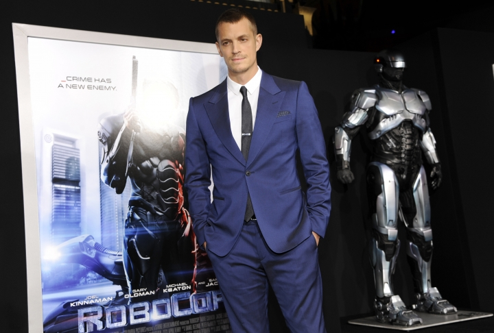 "FILE - In this Feb. 10, 2014 file photo, actor Joel Kinnaman appears at the premiere of ""Robocop"" in Los Angeles. MGM is developing the sequel ""RoboCop Returns"" with ""District 9"" and ""Elysium"" filmmaker Neill Blomkamp to direct. The film will be a sequel to Paul Verhoeven's 1987 original about a cyborg police officer in a crime-ridden Detroit. (Photo by Chris Pizzello/Invision/AP, File)"