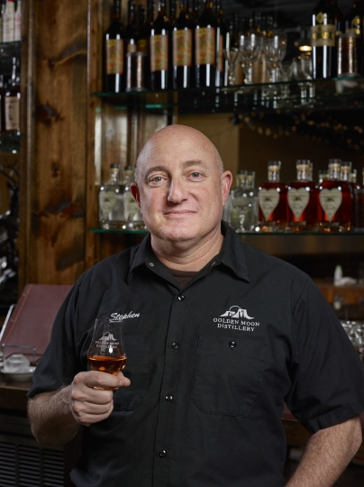 In this 2017 photo provided by Golden Moon Distillery, Steve Gould poses for a photo in Golden, Colo. Before Europe retaliated against new U.S. tariffs with taxes of its own, Gould expected export revenue at his Golden Moon Distillery in Colorado to grow 15 percent to about 25 percent this year. Now he's concerned. Golden Moon already saw an effect when then-candidate Donald Trump made trade an issue during the 2016 campaign. Gould lost one of his Mexican importers and an investor, as overseas demand for small-distiller spirits was growing. (Sounders Studios/Golden Moon Distillery via AP)