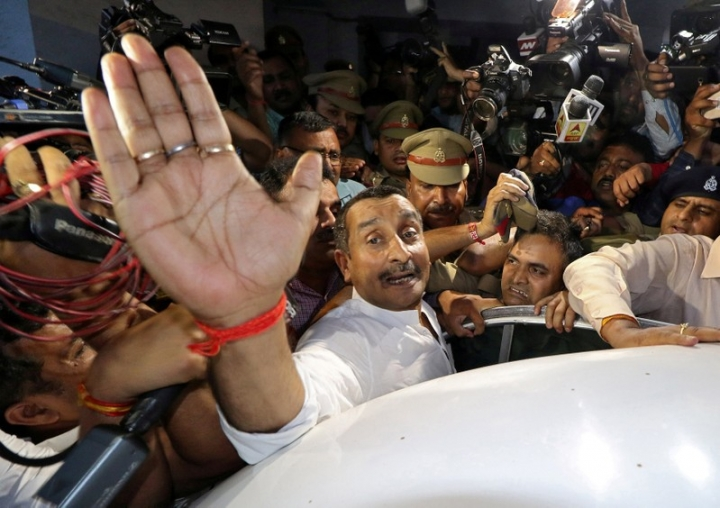 FILE PHOTO: Kuldeep Singh Sengar, a legislator of Uttar Pradesh state from India's ruling Bharatiya Janata Party (BJP), reacts as he leaves a court after he was arrested on Friday in connection with the rape of a teenager, in Lucknow, India, April 14, 2018. REUTERS/Pawan Kumar/File Photo