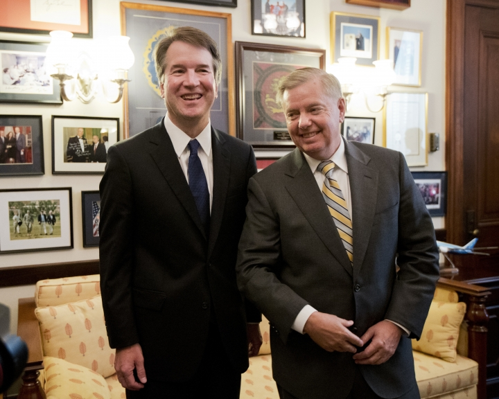 Supreme Court nominee Brett Kavanaugh, left, stands with Sen. Lindsey Graham, R-S.C. before the start of their meeting on Capitol Hill in Washington, Wednesday, July 11, 2018. (AP Photo/Manuel Balce Ceneta)