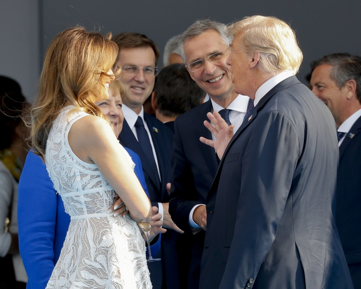President Donald Trump, right, and first lady Melania Trump, left, talk with German Chancellor Angela Merkel second from the left and NATO Secretary General Jens Stoltenberg at the Parc du Cinquantenaire in Brussels, Belgium, Wednesday, July 11, 2018. (AP Photo/Pablo Martinez Monsivais)