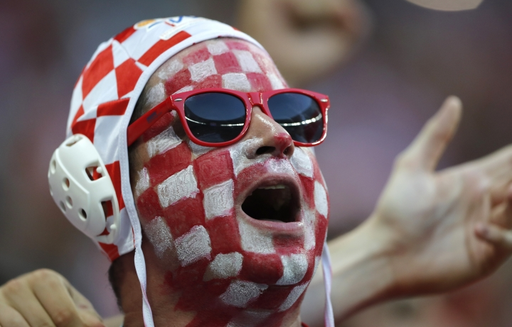 A Croatia fan cheers prior to the semifinal match between Croatia and England at the 2018 soccer World Cup in the Luzhniki Stadium in Moscow, Russia, Wednesday, July 11, 2018. (AP Photo/Frank Augstein)