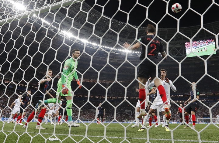 Croatia's Sime Vrsaljko clears a header from England's John Stones off the line during the semifinal match between Croatia and England at the 2018 soccer World Cup in the Luzhniki Stadium in Moscow, Russia, Wednesday, July 11, 2018. (AP Photo/Frank Augstein)