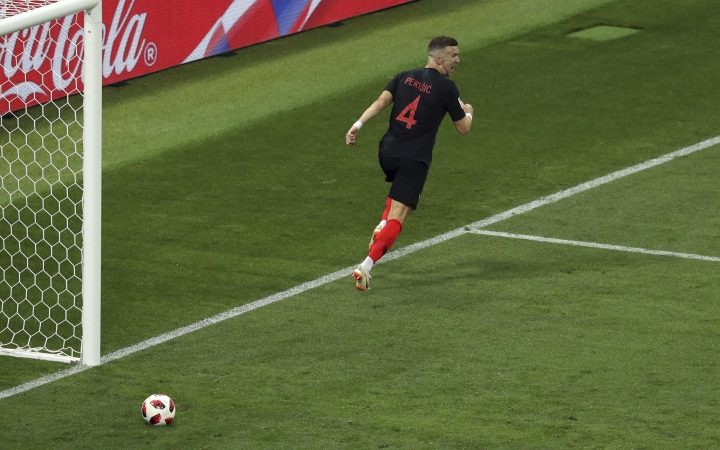 Croatia's Ivan Perisic celebrates after scoring his side's first goal during the semifinal match between Croatia and England at the 2018 soccer World Cup in the Luzhniki Stadium in Moscow, Russia, Wednesday, July 11, 2018. (AP Photo/Thanassis Stavrakis)