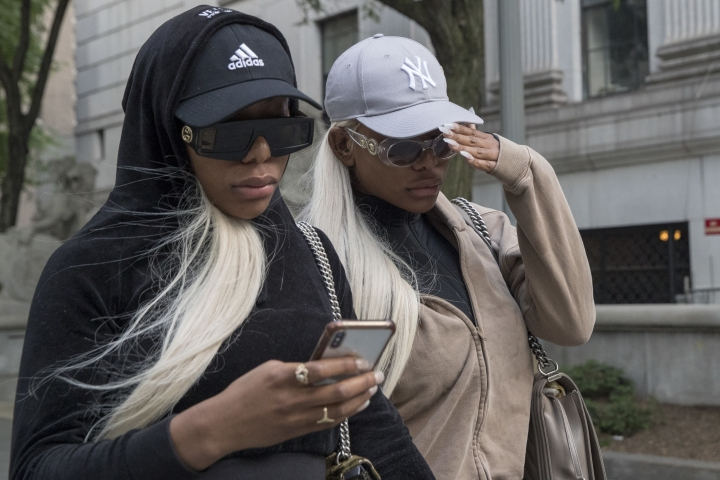 "Shannade Clermont, right, and her twin sister Shannon leave Federal court in New York after her arraignment, Wednesday, July 11, 2018. Shannade Clermont, a former cast member of the television reality series ""Bad Girls Club"" was arrested on charges alleging she stole debit card information from a man who died shortly after a date with her. (AP Photo/Mary Altaffer)"