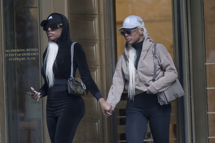 "Shannade Clermont, right, and her twin sister Shannon leave Federal court in New York after her arraignment, Wednesday, July 11, 2018. Shannade Clermont, a former cast member of the television reality series ""Bad Girls Club,"" was arrested on charges alleging she stole debit card information from a man who died shortly after a date with her. (AP Photo/Mary Altaffer)"