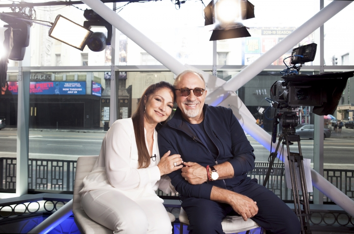 """In this July 9, 2018 photo, Gloria and Emilio Estefan pose for a portrait at BiteSize Studio in Los Angeles to promote their touring musical """"On Your Feet!."""" (Photo by Rebecca Cabage/Invision/AP)"""