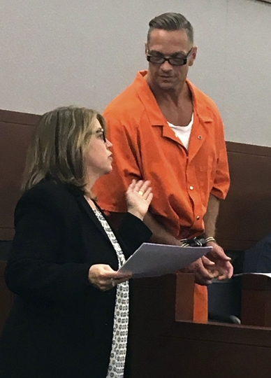 FILE - In this Aug. 17, 2017, file photo, Nevada death row inmate Scott Dozier, right, confers with Lori Teicher, a federal public defender involved in his case, during an appearance in Clark County District Court in Las Vegas. Dozier is slated to die by a three-drug lethal injection combination never before tried in any state and has said repeatedly he wants his sentence carried out and he doesn't care if it's painful. (AP Photo/Ken Ritter, File)
